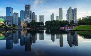 Kuala Lumpur Malaysia 12 Dec 2016: city at a lake with beautiful sky reflection during sunrise  .