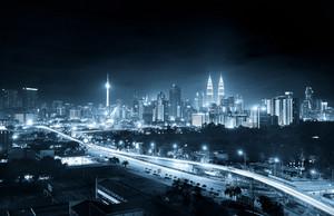 Kuala Lumpur skyline at night , mono blue tone