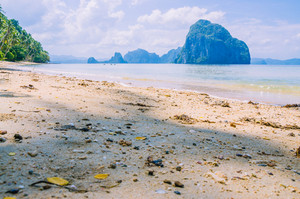 Landscape of El Nido. Sandy Beach with Huge Rock, Palawan island. Philippines