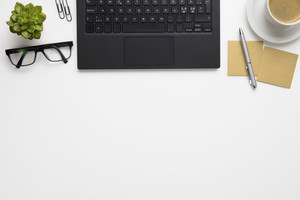 Laptop With Eyeglasses, Coffee Cup And Adhesive Notes On Desk