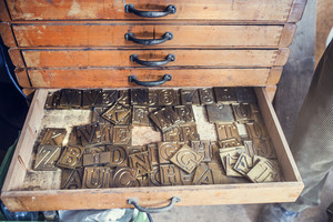 Letters for engraving in an old drawer in the workshop of a crafsman