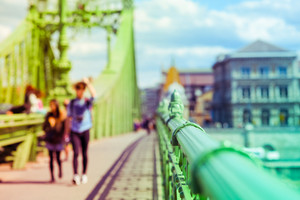 Liberty bridge in Budapest, Hungary with people walking on it. Defocus and blurred technique, filtered with vintage colour