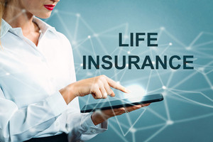 Life Insurance text with business woman using a tablet