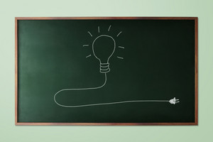 Light bulb  idea icon on chalk board. Chalk hand-drawn graphic style.