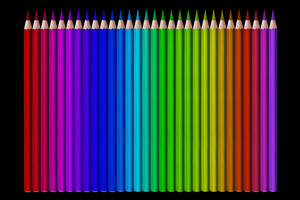 line of colored pencils on black background