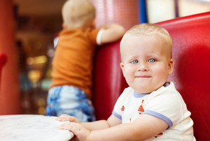 Little boy enjoying their time in cafe