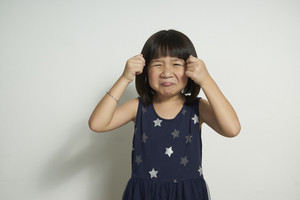 little girl rubbing her eyes crying