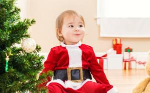 Little toddler girl smiling on Christmas morning