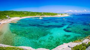 Lonely bay with azure water near Porto Pollo, Sardinia island, Italy