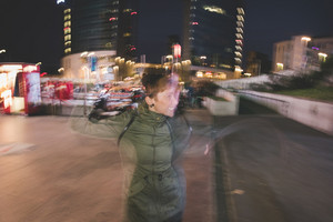 Long exposure knee figure of young handsome caucasian brown short hair woman dancing in the city at night - dancing, movement, happiness concept