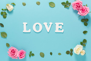 Love theme with flowers on a blue background