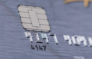Low angle view of the microchip and raised numbers on a bank card