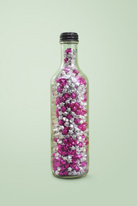 Lucky stars in a glass bottle with clippiing path