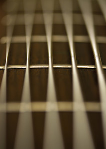Macro of a 6-strings bass guitar.