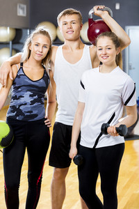 Male And Female Workout Team Standing Together In Gym