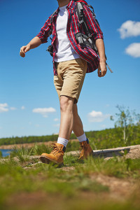 Male tourist with backpack traveling in the country