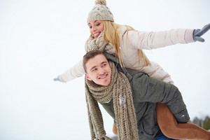 Man carrying his girlfriend on shoulders