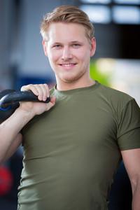Man holding kettlebell at crossfit center