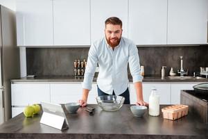 Man in kitchen. looking at camera