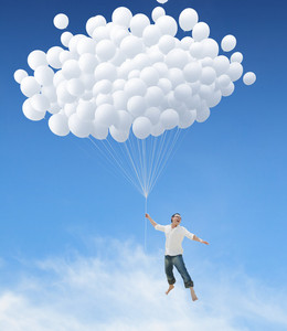 Man lifted into sky by huge bunch of white balloons