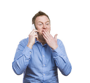 Man making funny faces while making a phone call. Studio shot on white background.