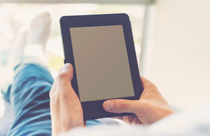 Man reading an e-book on digital device