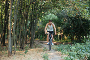 Man riding through the woods. full length image