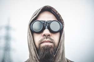 man with aviator glasses in a desolate landscape