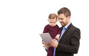 Man with his baby is working. Manager is using digital tablet.
