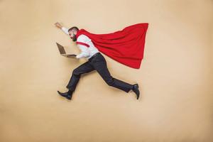 Manager with coat of superman. Superhero in studio.
