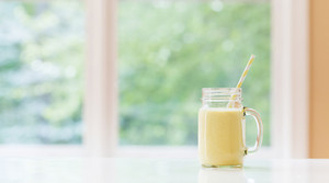 Mango smoothie beverage in a bright room