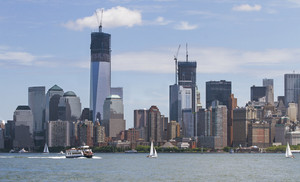 Manhatten shot from Liberty Island on day time in July. One World Trade Center under construction.