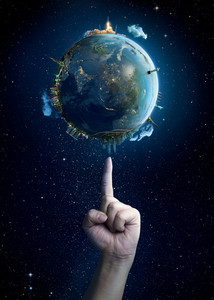 Man's hand touching the Earth.Elements of this image furnished by NASA