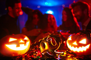 Masks and pumpkins at Halloween night