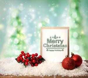 Merry Christmas card with baubles mistletoe and snow flakes