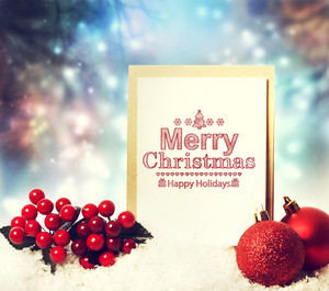Merry Christmas card with red baubles and mistletoe