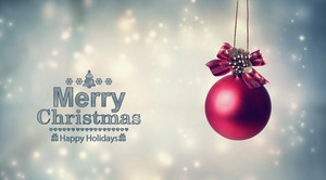 Merry Christmas message with a hanging bauble ornament