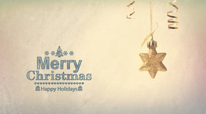 Merry Christmas message with a hanging star ornament