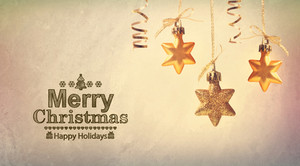 Merry Christmas message with hanging star ornaments