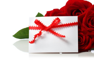 Message card with beautiful red roses on white background