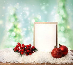 Message card with red ornaments over Christmas tree background