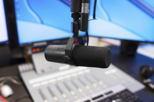 Microphone in modern radio station broadcasting studio