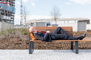 Middle age caucasian businessman relaxing lying down on a bench - relax, business, resting concept