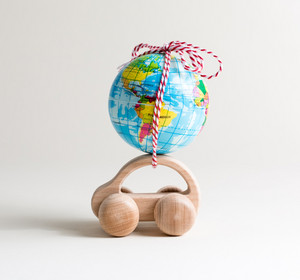 Miniature toy car carrying a small globe