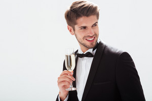 Model in suit. with champagne