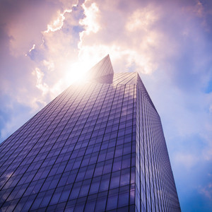 Modern office building (skyscraper) in sunlight. Toned image.