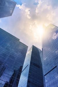 Modern office buildings (skyscraper) in sunlight. Toned image.