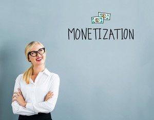 Monetization text with business woman on a gray background