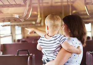Mother with son travel in retro train.