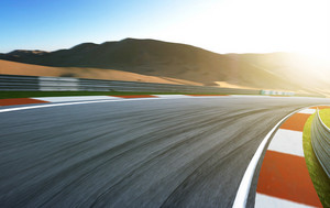Motion blurred race track .